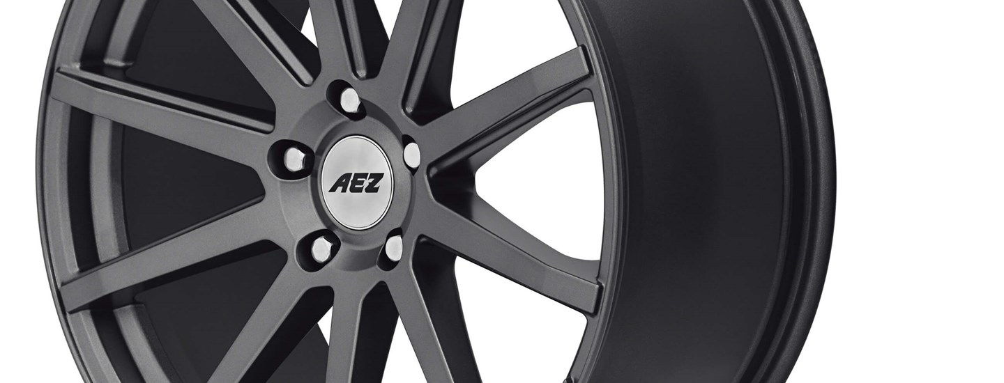 AEZ Straight dark alloy wheel close up full above