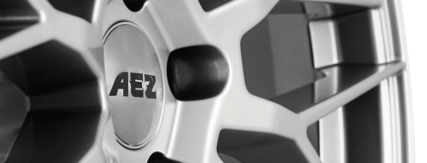 AEZ Crest silver alloy wheel cross-spoke close up from above