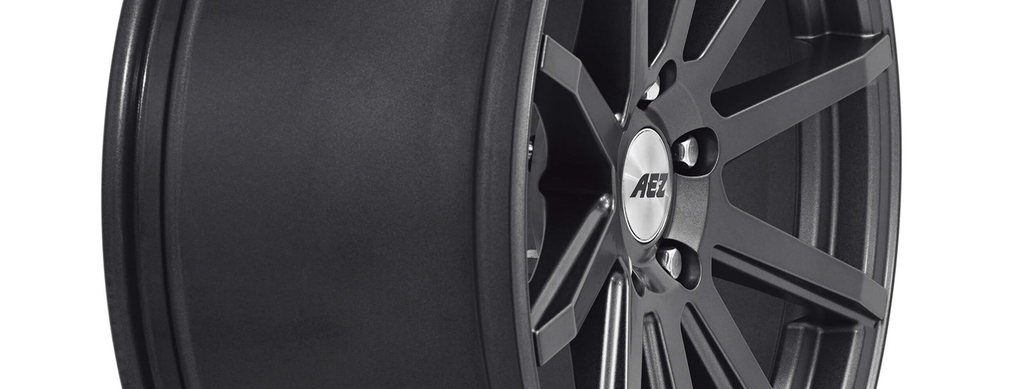AEZ Straight dark alloy wheel close up extreme side width 9,5